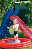 Little boy in th pool. Little boy playing in wading pool Stock Photos