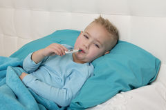 Little boy with a thermometer Stock Photos