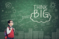 Little boy with Think Big text Stock Image