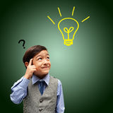 Little boy thinking get idea green Royalty Free Stock Images