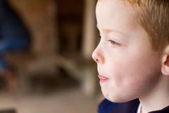 Little boy thinking side profile Stock Images