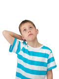 Little boy thinks looking up. Portrait of a puzzled kid isolated on white background - white blond boy with big eyes rolled up, thinking or calculating Stock Images