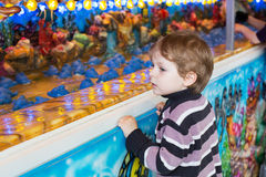 Little boy of three years at a funfair, outdoors Royalty Free Stock Images