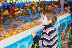 Little boy of three years at a funfair, outdoors Stock Images