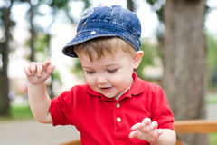 Little boy throwing a rock Stock Photos