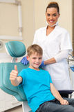Little boy thumb up. Cute little boy thumb up in dentist office Stock Photo