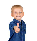 Little boy with thumb up. Portrait of a cute smiling little boy with thumb up in denim blue shirt isolated on white background Stock Photo