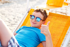 Little boy thumb up and relaxing Royalty Free Stock Images