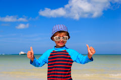 Little boy thumbs up on summer beach Royalty Free Stock Photos