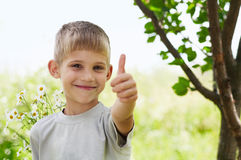 The little boy is thumbup Royalty Free Stock Image