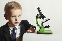 Little boy in tie. child.children.Schoolboy working with a microscope.Smart boy Stock Photography