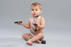 Little boy in tie speaks with cell phone Royalty Free Stock Photo