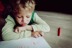 Little boy tired stressed of doing homework. Little boy tired stressed bored of writing, doing homework Stock Image