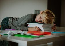 Little boy tired stressed of doing homework, bored, exhausted. Overload royalty free stock photos