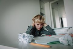 Little boy tired stressed of reading, doing homework. Little boy tired stressed exhausted of reading, doing homework stock photos