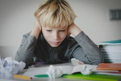 Little boy tired stressed of reading, doing homework. Little boy tired stressed exhausted of reading, doing homework stock photo