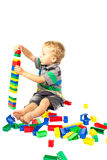 A little boy to build a tower of Lego Stock Photography