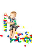 A little boy to build a tower of Lego Royalty Free Stock Image