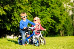 Little boy and toddler girl on bikes in summer Royalty Free Stock Photo