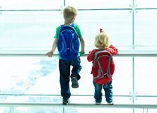 Little boy and toddler girl looking at planes in. The airport, kids travel Royalty Free Stock Photography