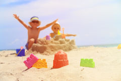 Little boy and toddler girl play with sand on beach Royalty Free Stock Photo
