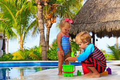 Little boy and toddler girl playing in swimming Royalty Free Stock Photography