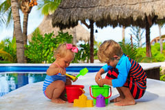 Little boy and toddler girl playing in swimming Royalty Free Stock Photos