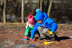 Little boy and toddler girl playing with water in Stock Image