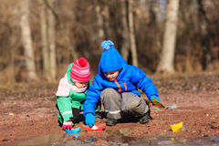 Little boy and toddler girl playing with water in Royalty Free Stock Image