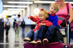 Little boy and toddler girl travel in the airport Stock Images