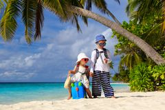 Little boy and toddler girl travel on summer beach Royalty Free Stock Photos