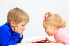 Little boy and toddler girl using touch pad Royalty Free Stock Photo