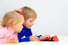 Little boy and toddler girl using touch pad Stock Image
