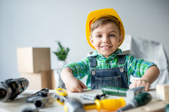 Little boy with tools Royalty Free Stock Photo