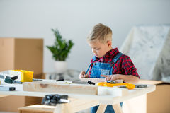 Little boy with tools Royalty Free Stock Images
