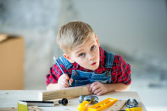 Little boy with tools Royalty Free Stock Photos