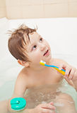 Little boy with toothbrush stock images