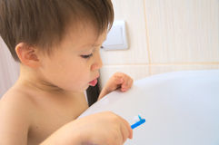 Little boy with toothbrush stock photo