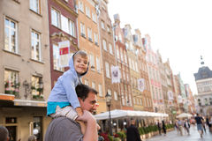 Little boy on top of his father's shoulders. Happy little boy on top of his father's shoulders siteseeing european city center stock image