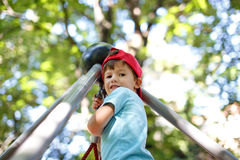 Little boy at top of jungle gym Stock Photography