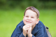 Little boy with a torn front first milk tooth Royalty Free Stock Images
