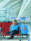 Little boy with touch pad in the airport Royalty Free Stock Photo
