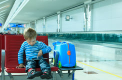 Little boy with touch pad in the airport Stock Image