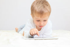 Little boy with touch pad Royalty Free Stock Photography