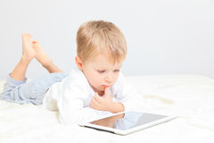 Little boy with touch pad Stock Photos