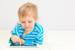 Little boy with touch pad Stock Photo