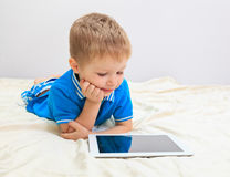 Little boy with touch pad, early learning Stock Image