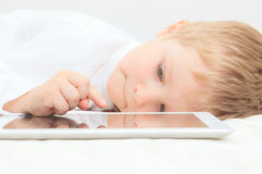 Little boy with touch pad Stock Images