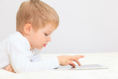 Little boy with touch pad Royalty Free Stock Images