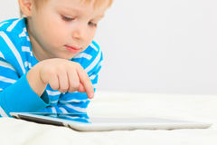 Little boy with touch pad Stock Photography